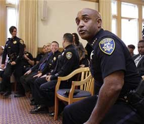 Former Oakland Police Chief Anthony Batts moves out of his chair during a news conference with Oakland Mayor Jean Quan and new Oakland interim police chief Howard Jordan at Oakland City Hall in Oakland, Calif., Thursday, Oct. 13, 2011. Batts resigned on Tuesday and was replaced by Jordan.