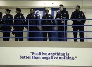 Corrections officers wait for the start of a news conference in an enhanced supervision housing unit on Rikers Island in New York, Thursday, March 12, 2015. (AP Photo/Seth Wenig)