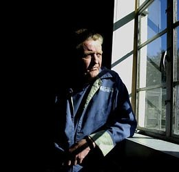 Dennis Whitney looks out a windowduring an interview room at Union Correctional Facility in Raiford, Fla. Whitney has been incarcerated for more than 44 years. (AP Photo/Oscar Sosa)
