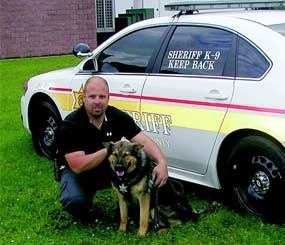 Ozzie and his handler Deputy John Demeo (Delaware County Sheriff's Office Image)