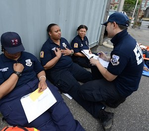 Paramedic students hold a mock disaster drill.