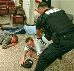 At-large parolees are arrested in an auditorium during a sting operation at the California State Building in Oakland, Calif. on Saturday, May 15, 2010. (AP photo)