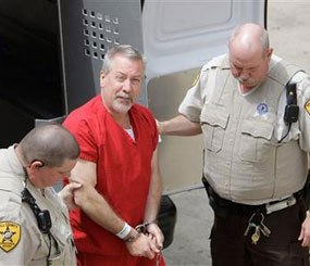 In this May 8, 2009 file photo, former Bolingbrook, Ill. police Sgt. Drew Peterson arrives at the Will County Courthouse in Joliet, Ill., for his arraignment on charges of first-degree murder in the 2004 death of his former wife Kathleen Savio. (AP Photo)