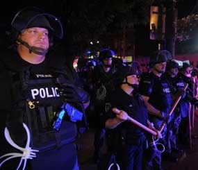 Police officers from various agencies prepare for riots in Pittsburgh. (AP Photo)