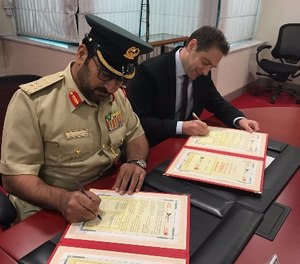 PoliceOne CEO Alex Ford signs a memorandum of understanding to bring PoliceOne Academy training to the Dubai Police Force. (Image courtesy Nicole Forzano)