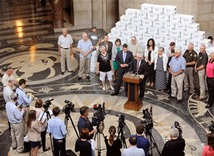 Death penalty supporters stand in front of boxes they say contain 166,692 petition signatures, enough to block the repeal of the death penalty in Nebraska until voters decide the issue, during a news conference Wednesday, Aug. 26, 2015 at the state capitol in Lincoln, Neb. (Eric Gregory/The Journal-Star via AP)