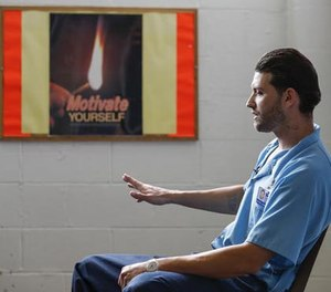 In this Oct. 17, 2016 photo, inmate Joshua Meador speaks about addiction at Sheridan Correctional Center in Sheridan, Ill. Meador, a recovering heroin addict, hopes to get into a Vivitrol program at Sheridan before his release in January. U.S. prisons are experimenting with the high-priced monthly injection that could help addicted inmates stay off opioids after they are released. (AP Photo/Kamil Krzaczynski)
