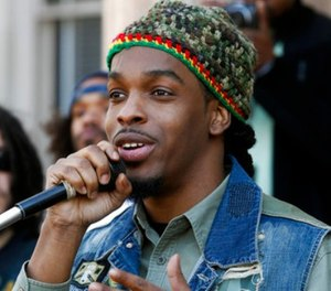 In this Sunday, April 20, 2014, file photo, Jawara McIntosh, son of legendary Reggae icon and a pro-marijuana activist, Peter Tosh, sings a song as he stands with a large gathering in front of the New Jersey Statehouse in Trenton, N.J. (AP Photo/Mel Evans, File)