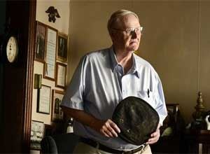 Ray Bogart, a former correction officer taken hostage during the Attica Prison riot, holds what remains of the uniform cap worn during the riot that was recently returned to him, at his home in Auburn, NY, Tuesday, Oct. 7, 2014.