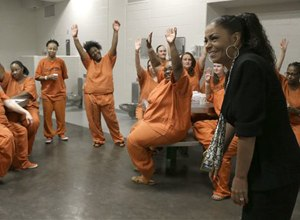Kathryn Griffin Grinan, left, reacts as Harris County jail inmates sing her praises during a group session Tuesday, June 4, 2013, in Houston. Griffin started and runs prostitution rehabilitation program We've Been There Done That. (AP Photo/Pat Sullivan)