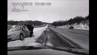 Careening car plows into Mich. cop assisting driver