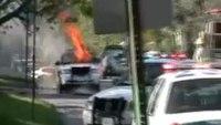 Firefighters battle police car blaze