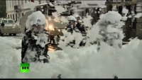 Protesting firefighters spray cops with foam