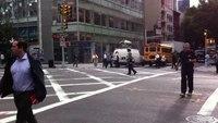 Female Manhattan cop dances while directing traffic