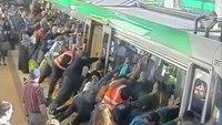 Passengers lift train to free trapped man