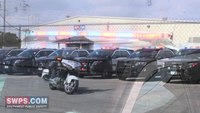 Texas police vehicles flashing in memory of fallen deputy