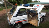 Police car converted into chicken coop