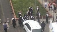 Massive group of UK cops TASER armed man