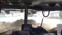Colo. fire truck driving through flood