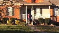 Off-duty firefighter rescues dog from house fire