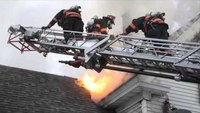 Maine firefighter falls through roof, rescued