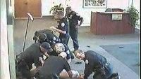 Video released of teen fighting police, firing officer's gun