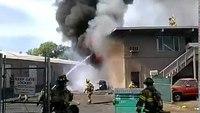 Firefighter falls through roof battling fire