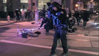 Flagpoles thrown at cops, pepperballs fired at Phoenix protest