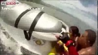 Firefighter's amazing jet ski rescue of drowning family