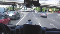 Hungarian ambulance speeds through traffic and red lights with sirens on