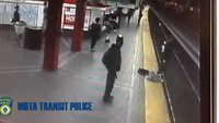 Boston cop saves suicidal man from tracks