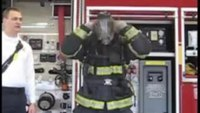 Firefighter dons PPE