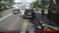 Woman causes accident trying to pass fire truck