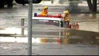 Fire truck drives through flood