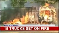 Trucks set on fire in protest after woman's death