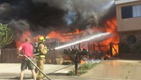 Vacationing firefighters help battle 2-alarm fire