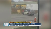 Buffalo police SUV hits man with knife
