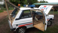 Police car converted into chicken coop
