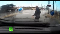Ohio cop saves driver moment before train smashes into van