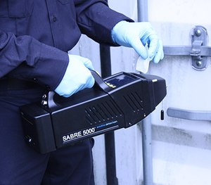 A detection tool like the handheld SABRE 5000 can alert COs to the presence of dangerous contraband substances in less than a minute. (photo/Smiths Detection)