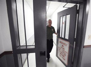Mount Olive maximum security prison warden, David Ballard, walks out of the secure area at the prison in Mount Olive, W. Va. (AP Photo/Steve Helber)