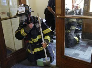 AP Photo/Steven SenneWorcester firefighter Lt. Jeffery Dubeau takes part in a test exercise for safety tracking devices Tuesday on the campus of Worcester Polytechnic Institute.