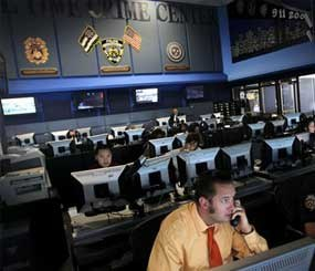 Employees work inside the Real Time Crime Center at New York police headquarters. 10 years after the Sept. 11 terror attacks, emergency agencies are better equipped for communication in a disaster