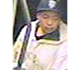 This image taken from a surveillance video and provided by the San Francisco Police Department show suspect Nikhom Thephakaysone on a MUNI train in San Francisco.