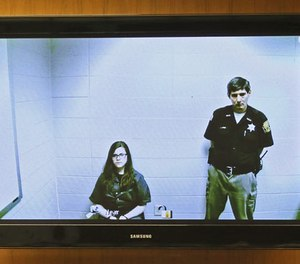 Anissa Weier, left, appears via video link from the Washington County Secure Detention Center where she is being held, during a hearing in Waukesha County Court, Friday, Nov. 11,2016, in Waukesha, Wis.  (Michael Sears/Milwaukee Journal-Sentinel via AP, Pool)
