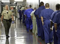 How are 'snitches' treated in prison?