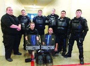 Kneeling, from left: Kevan Sipla, Marcus Hernandez, (standing) Sgt. Angelo Brock, Joshua Huff, Kenneth Koepsell, Bradley Morris, Cpl. Daniel Gonzales and Joshua Howard.
