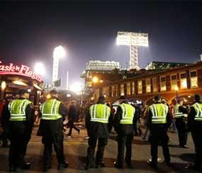 Law enforcement officials form a line along a street outside Fenway Park, background, following Game 6 of baseball's World Series between the Boston Red Sox and the St. Louis Cardinals in Boston. The Red Sox won 6-1 to win the series. (AP
