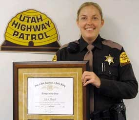 Utah Highway Patrol Officer Lisa Steed holds her award after being named Trooper of the Year.
