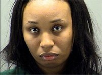 Woman hides $1,700, drugs in underwear during booking